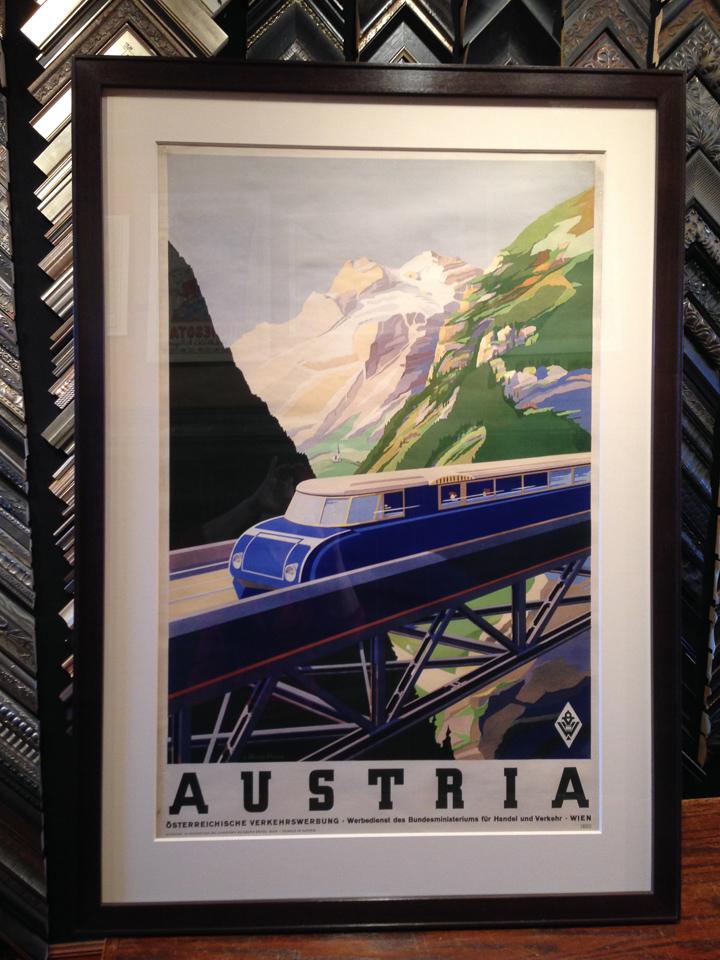 Vintage travel poster framed in ebony walnut.
