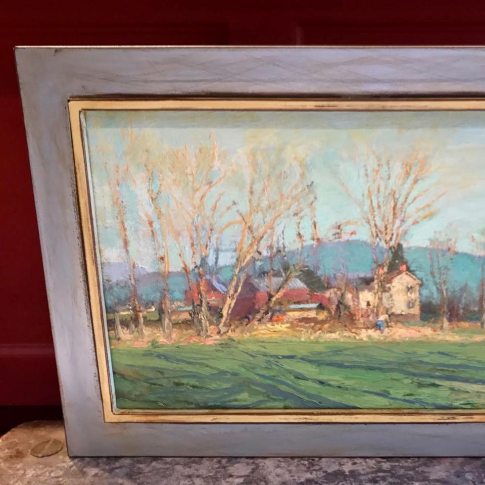 Lovely landscape painting framed in welded steel frame.