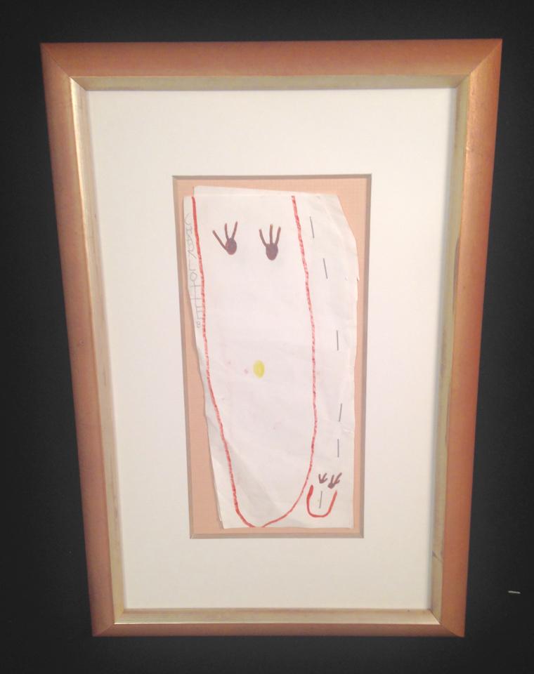 Children's drawing framed in blush silver.