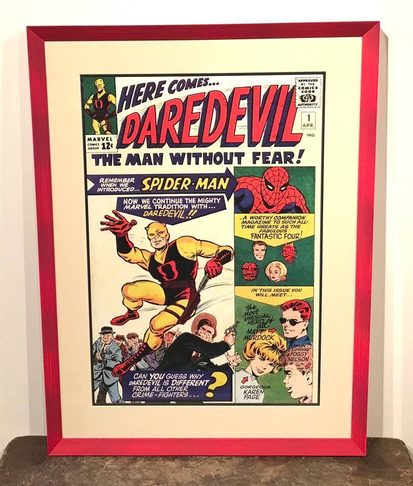 Fun Daredevil print framed in red.