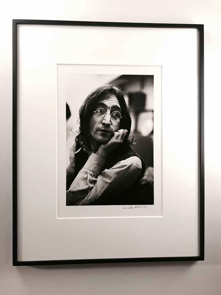 Beautiful image of John Lennon framed classically in a closed-corner black with 8 ply matting.