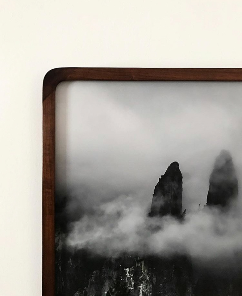 Photograph framed in rounded walnut.