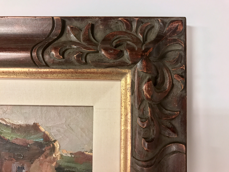 Detail of hand-carved frame with 22 kt gold lip and silk liner.