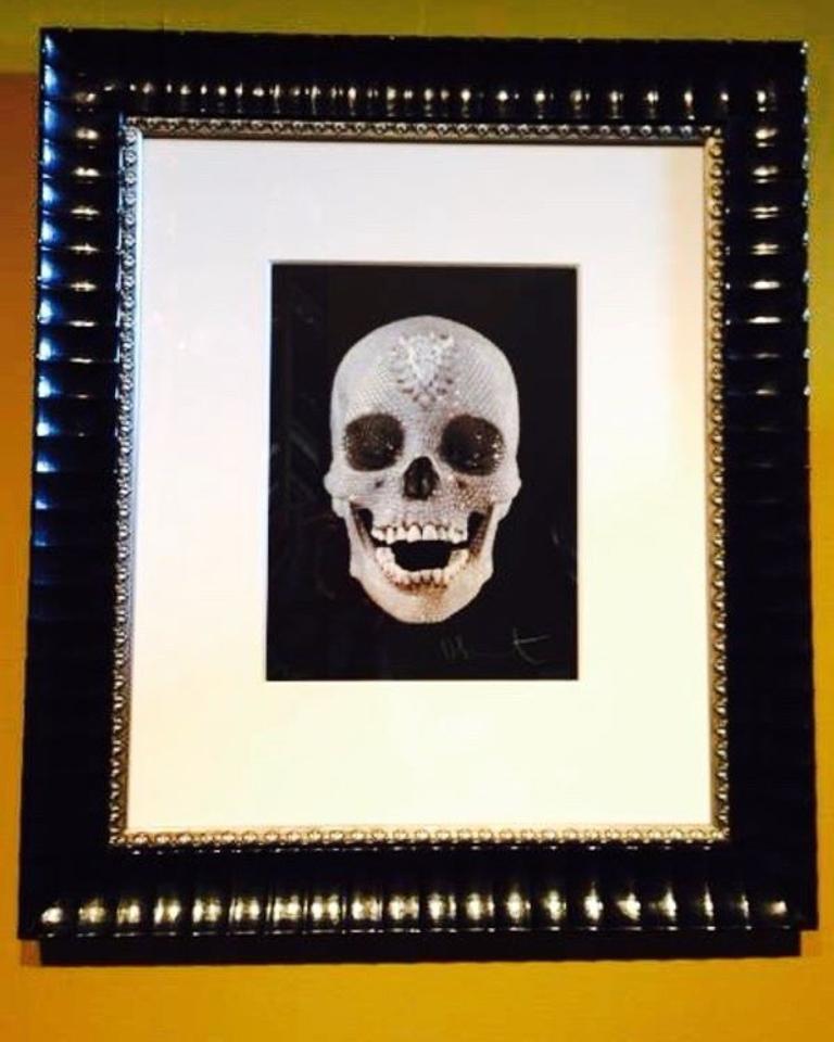 Bejeweled Damien Hirst print framed in patterned black with beaded silver fillet.