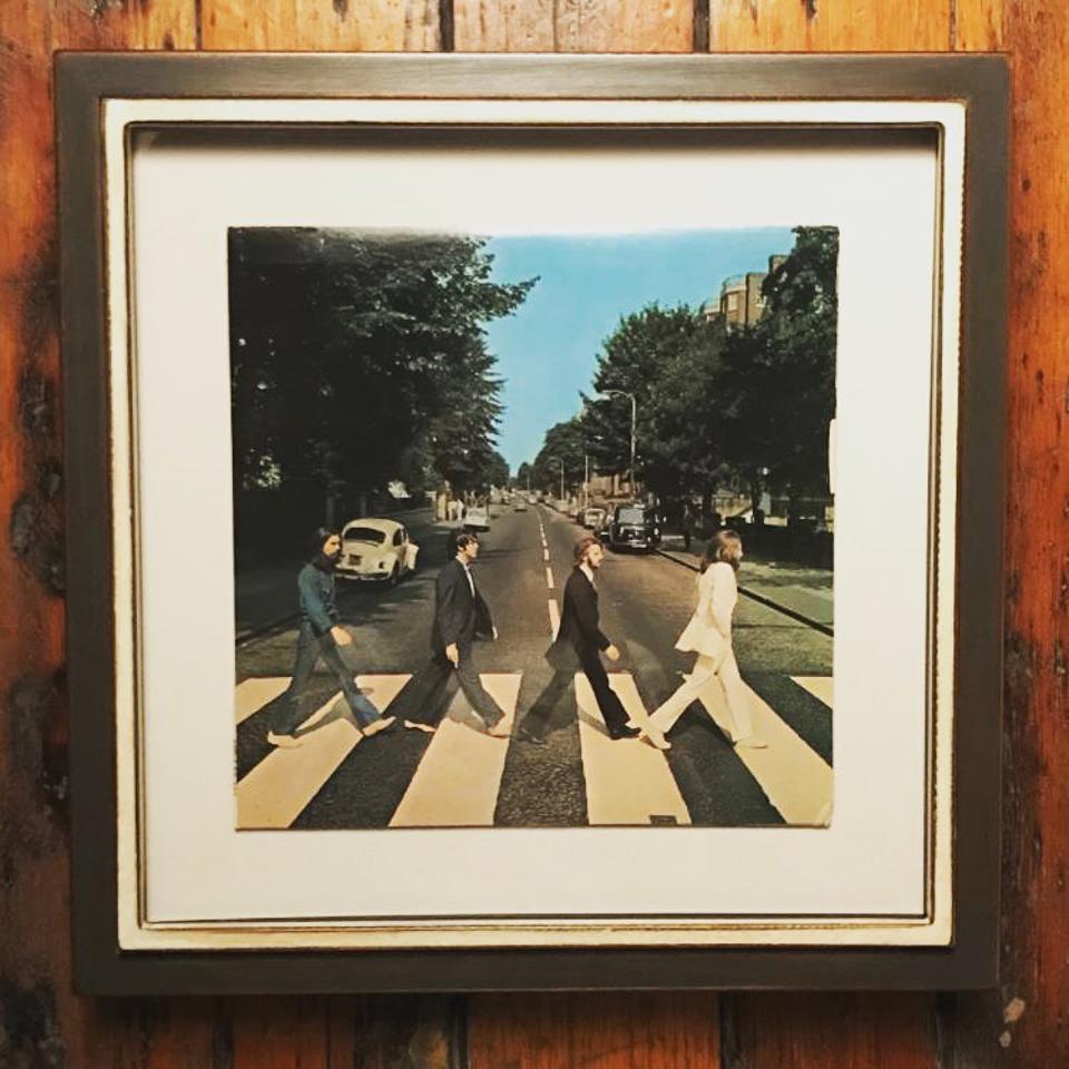Beatles album framed in painted steel.