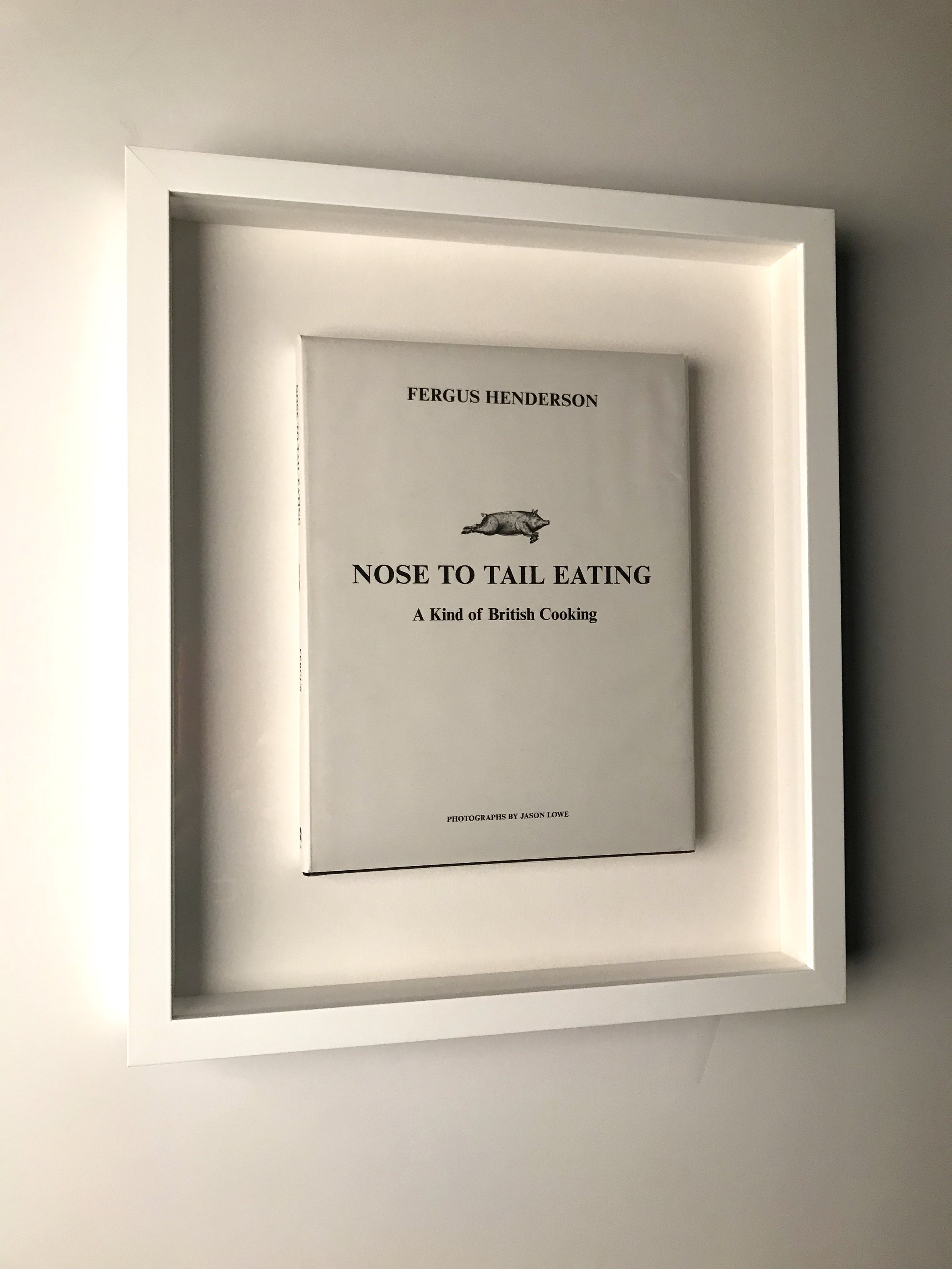 First edition book float mounted and shadowboxed.