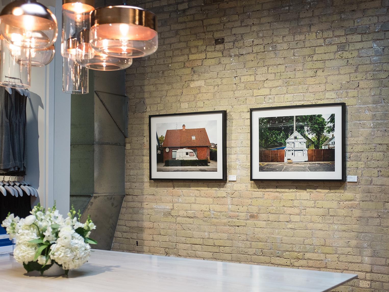 Photographs by Craig VanDerSchaegen framed in classic black gallery frames.