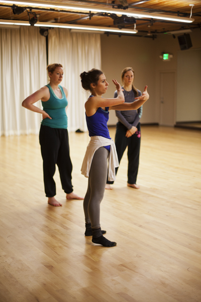 Dancer Madeline Cameron discussing logistics with Holly Logan during company rehearsal. Also pictured (from left to right): Dancers Lindsay Johns & Jessica Mego. Photo courtesy of  S. Weissbach Photography .