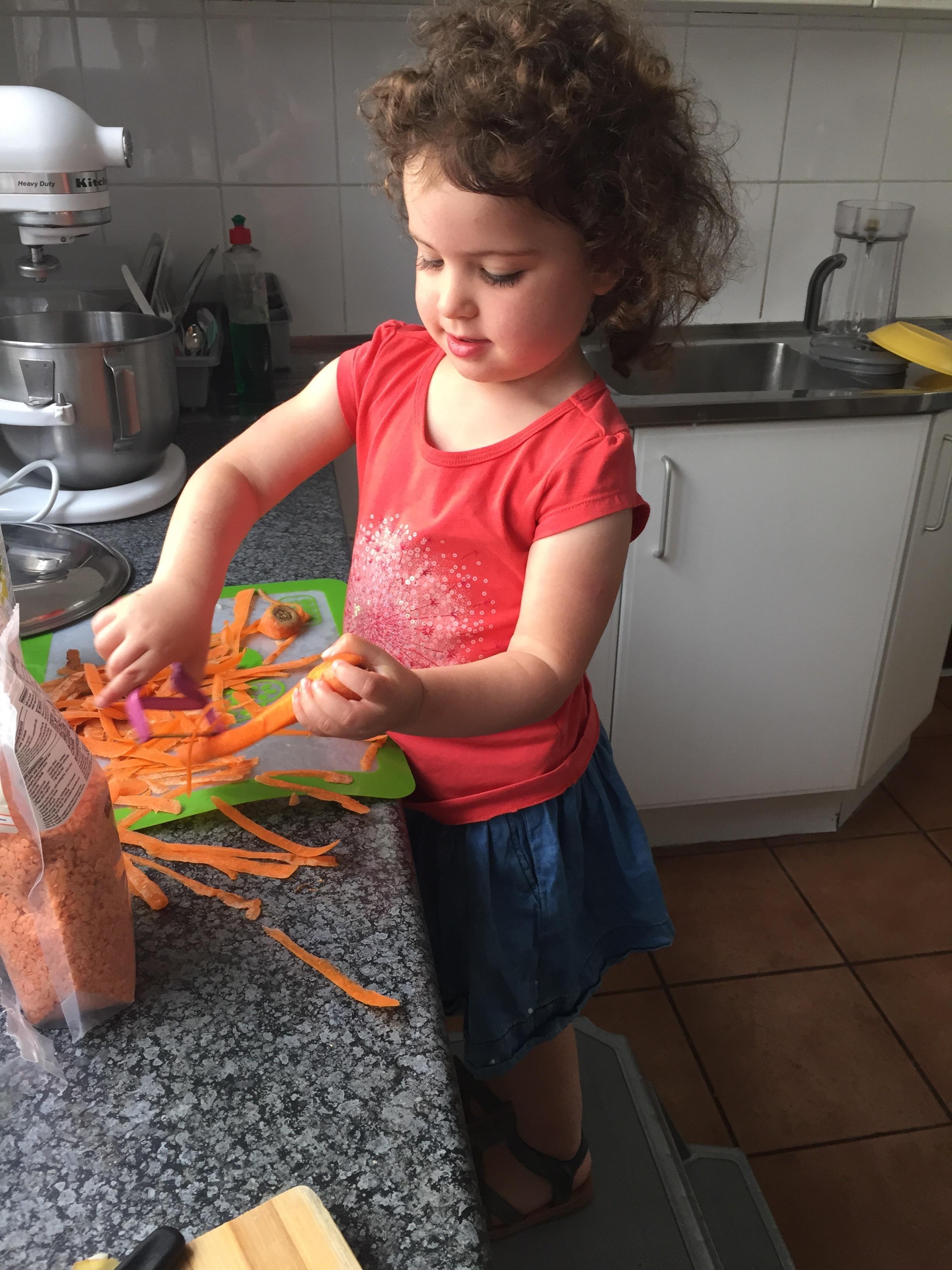 Laya helping me peel the carrots.
