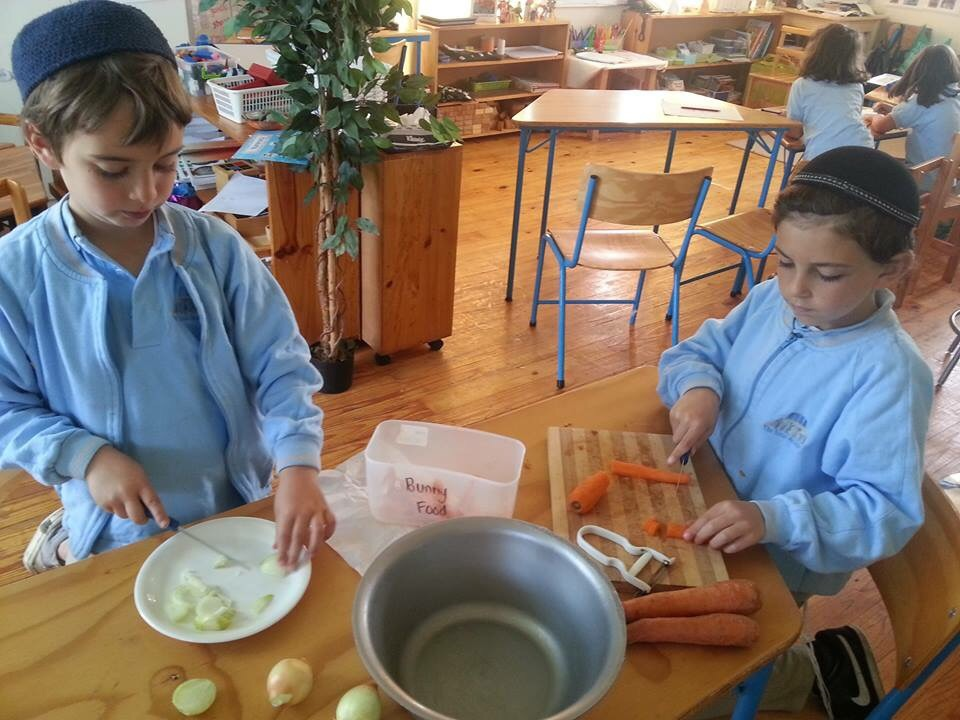 Menny and his cousin Menach preparing the soup in their awesome school- Sinai Academy!