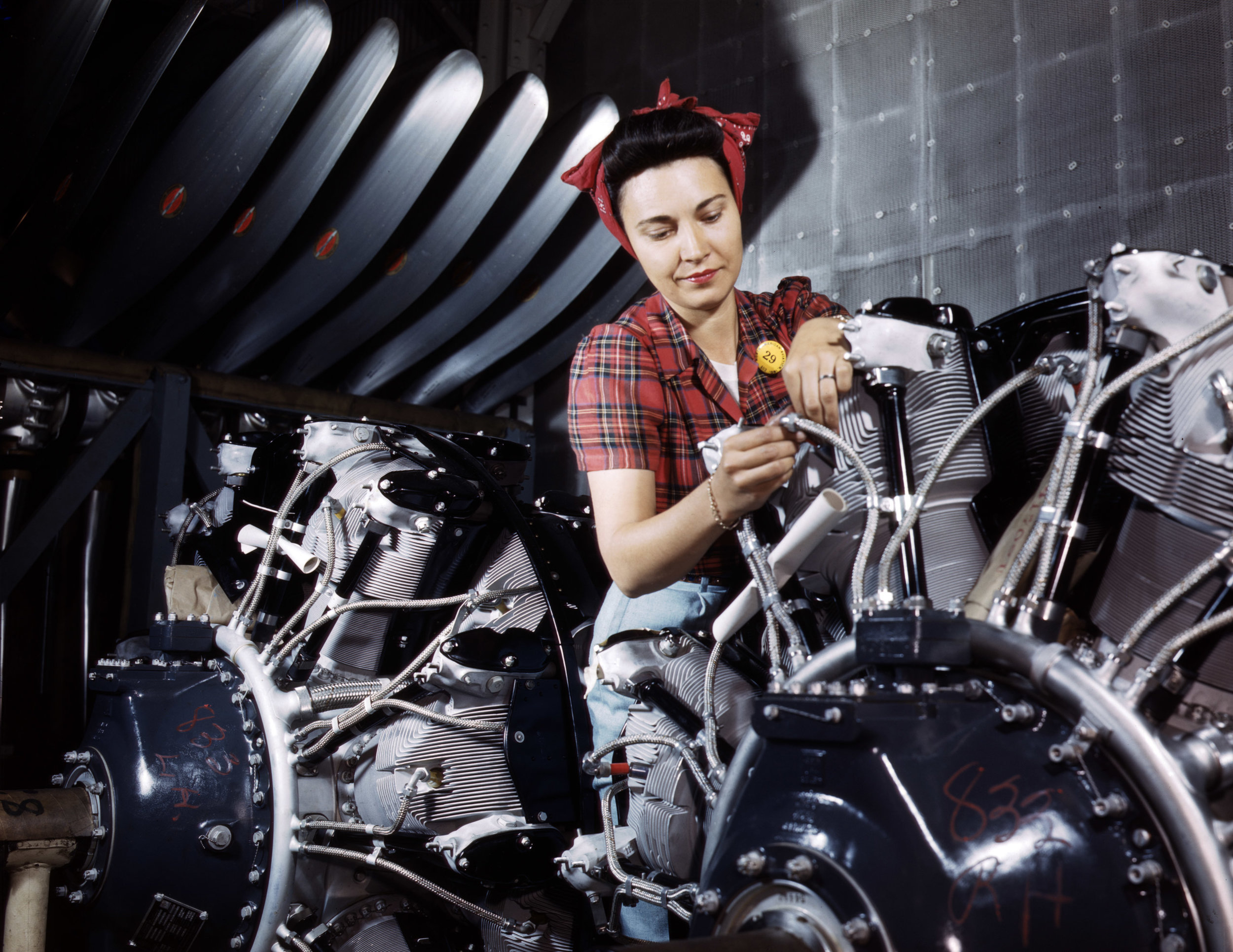 Working on an airplane motor at North American Aviation, Inc., plant in California. Photographer: Alfred T. Palmer