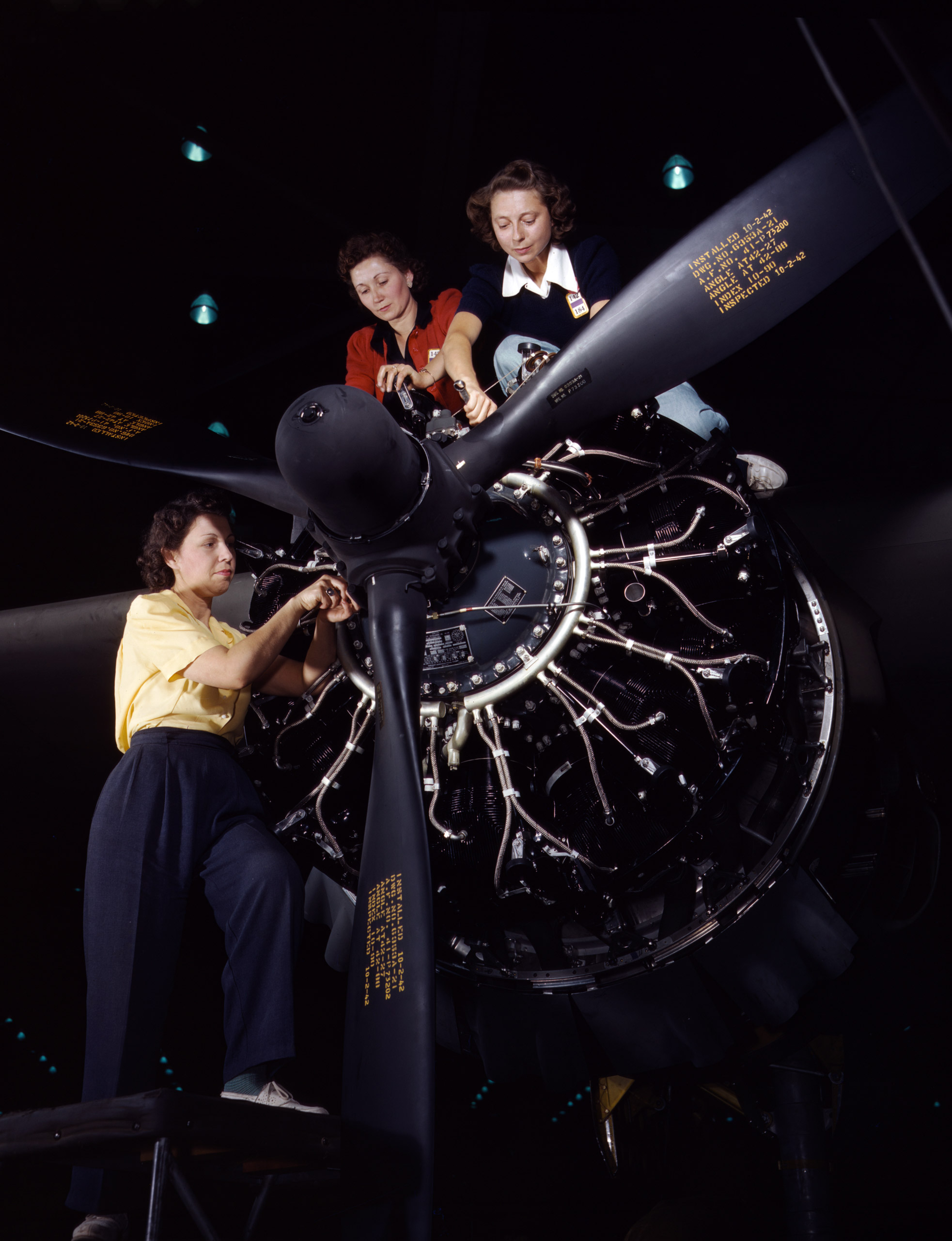 Precise engine installation duties at Douglas Aircraft Company, Long Beach, California. Photographer: Alfred T. Palmer