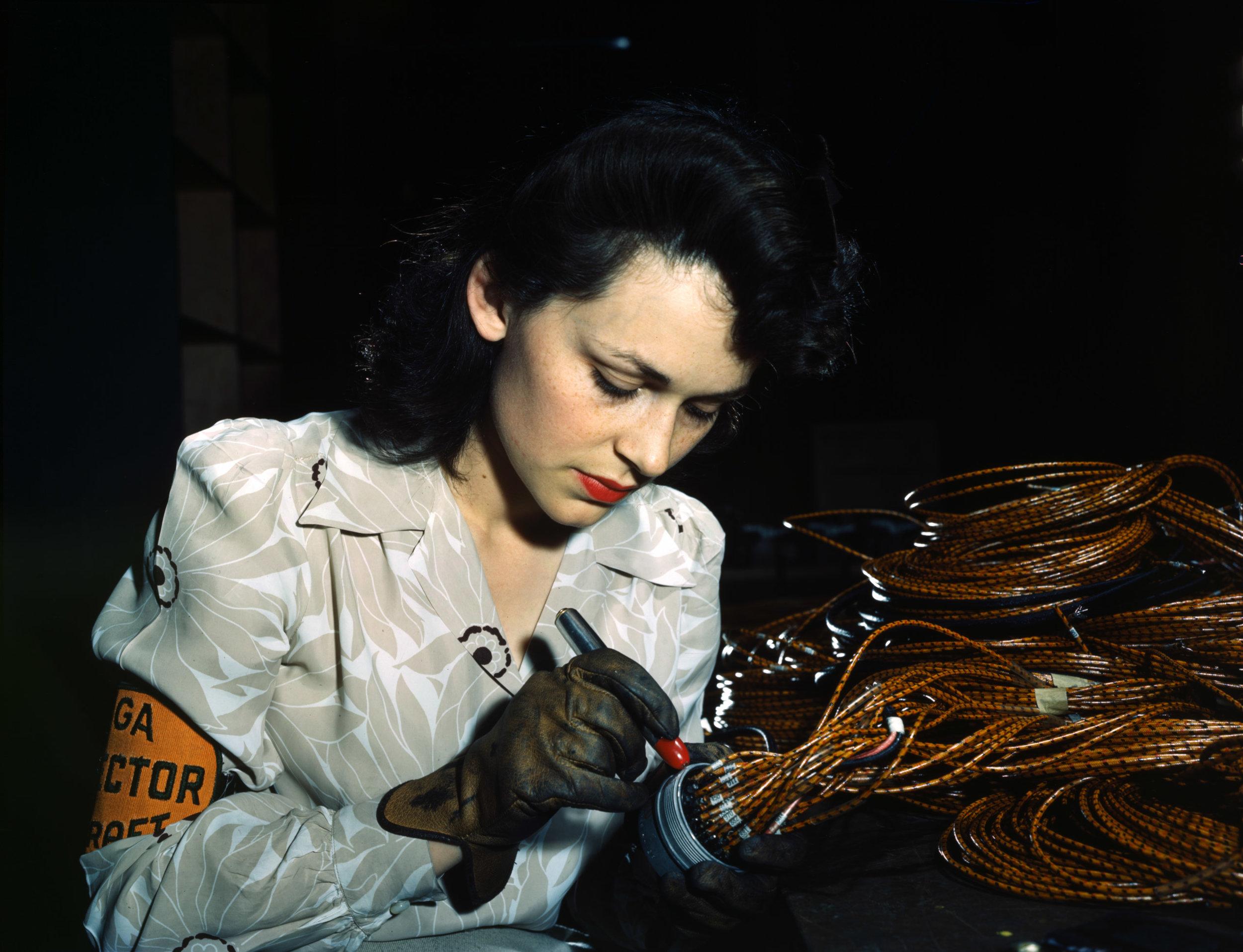 Checking electrical assemblies at Vega Aircraft Corporation, Burbank, California. Photographer: David Bransby