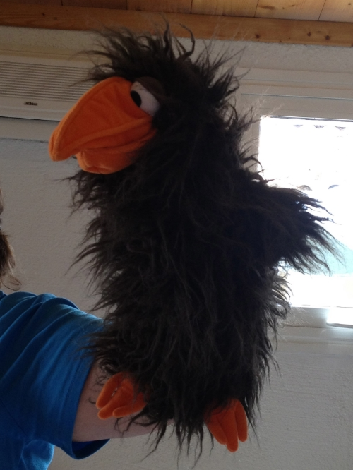 Puppets are just one of the ways children can safely express themselves in play therapy.