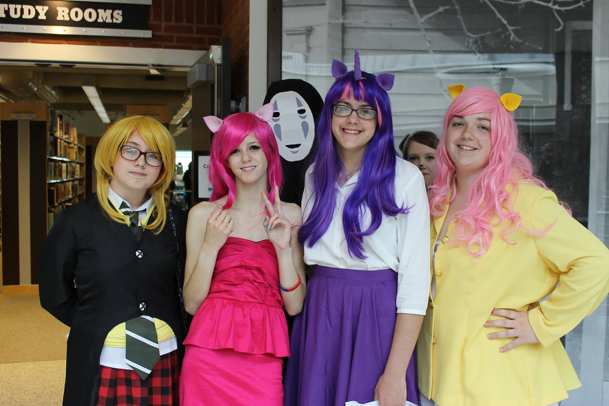 Anime loving girls (and No Face! from  Spirited Away ) pose for a picture.