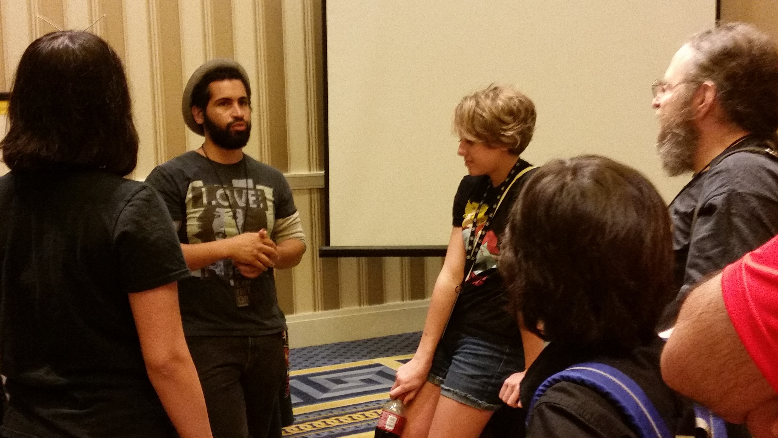 Andrew Smart speaking to burgeoning artists after his workshop.