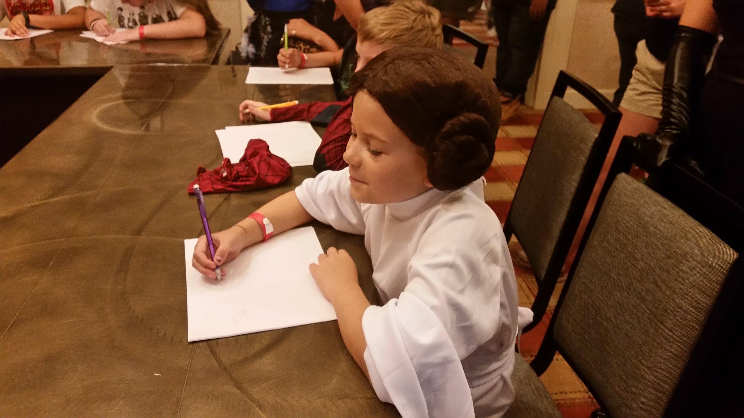 A Princess Leia Cosplayer draws a fox during Keir Lyles