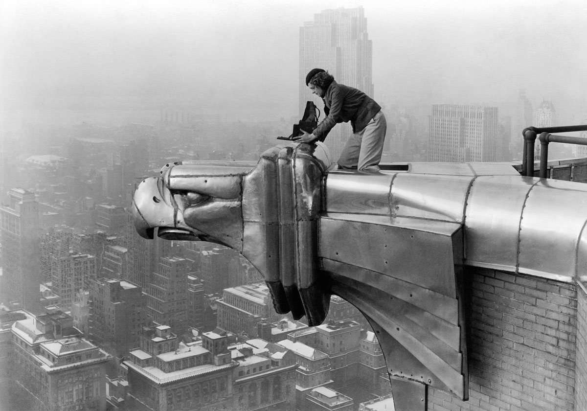 Margaret Bourke-White, a photographer for  LIFE  magazine, makes a precarious photo from one of the eagles on the 61st floor of the Chrysler Building in New York City in 1934.