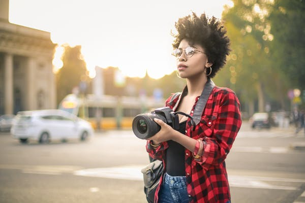 Women photographers can access places and document experiences that male artists can't.  Merla/Shutterstock