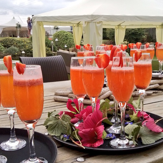 Pimms drink reception with fresh strawberries