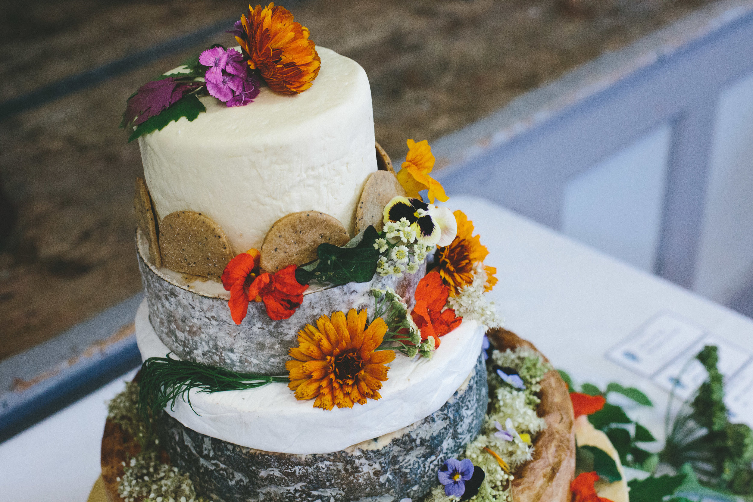 Whole Marigolds decorating this cake of cheese