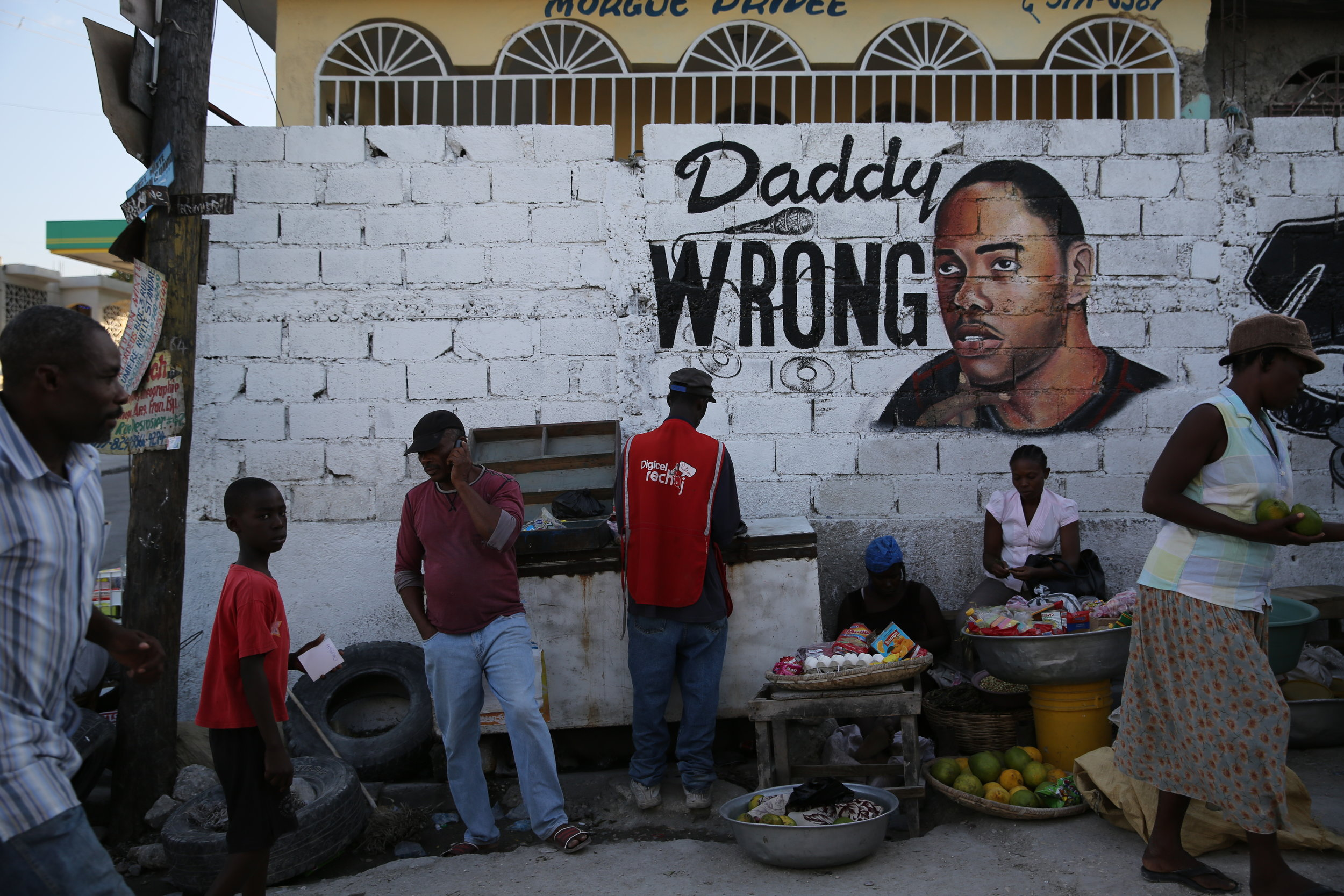 "In the Delmas 33 section of Port-au-Prince, a group of deportees in a media group called ""33rd Side"" helped   arrange a mural and wake for a man in the neighborhood that was killed by gun violence for unknown reasons. This group believes in the importance of the community."