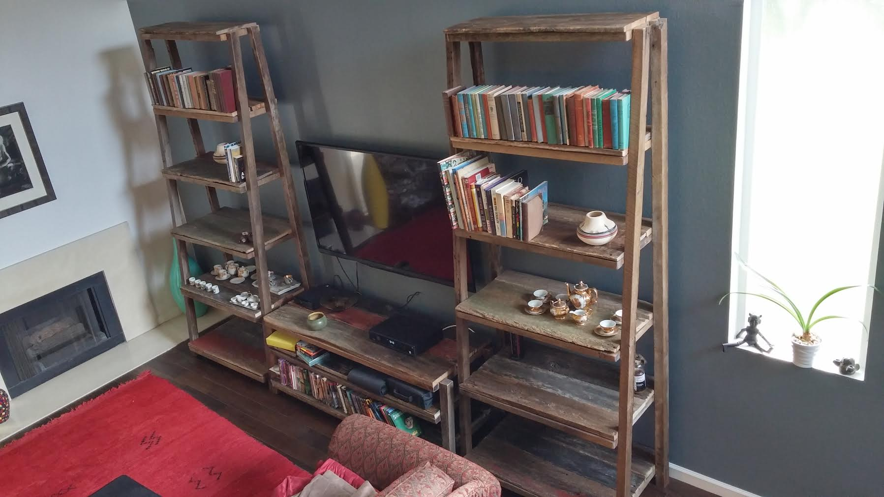 With a little over 200sqft in reclaimed wood material, this DIY customer made a one of kind living room shelving unit/ book case/television entertainment center. They did a great job at showcasing the design possibilities ofour reclaimed lumber!