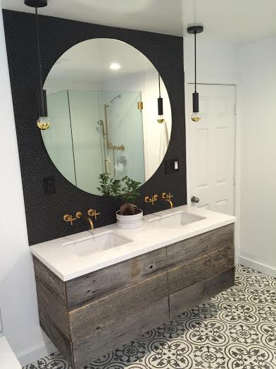 This bathroom vanity was hand crafted using reclaimed oak barn boards. Our customer e-mailed us a few inspiration pics they liked for their bathroom remodel & we designed this double sink vanity. Adds the perfect touch to complete theirbathroom design!