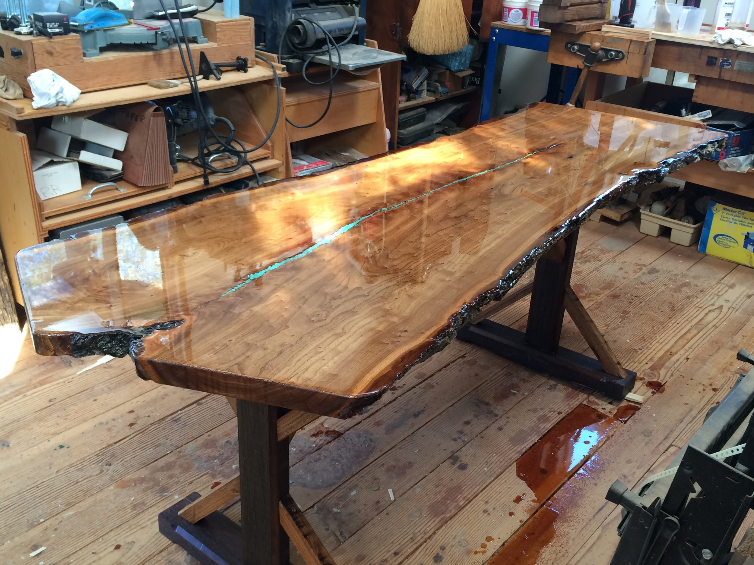This magnificent elm slab with a beautiful live edge is a table top project designed and completed by one of our customers. The elm slab table top is a work of art with the turquoise streaming through the middle. U.S. Reclaimed, Vintage Lumber & Wood Works offers a variety of extraordinary slab pieces. You can visit the store to check out our selection and start your own project or have our team build a custom piece made just for you.