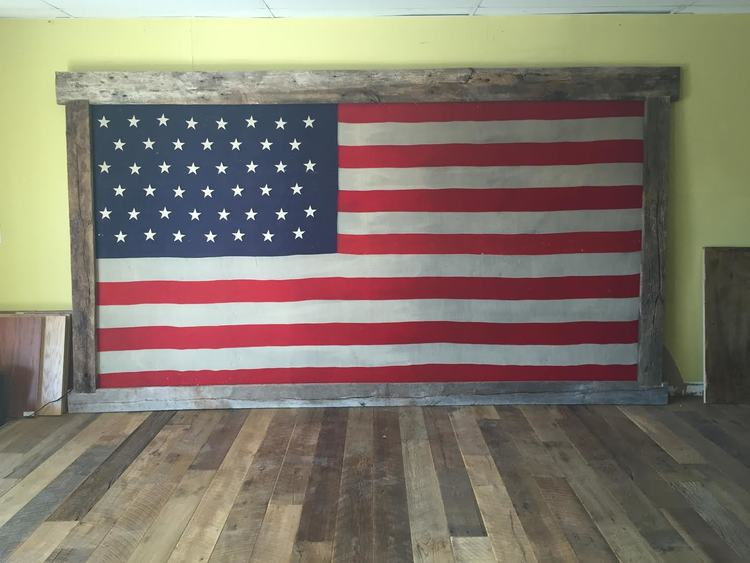 Picture perfect for Memorial Day: The American Flag framed in U.S. Reclaimed wood.  In observance of Memorial Day, U.S. Reclaimed, Vintage Lumber & Wood Works will be closed Saturday 5/27 - Monday 5/29. We will resume regular business hours Tuesday 5/30: 9 AM - 6 PM. Leave a message: sales@usreclaimed.com / #949-364-1207. Thank you to all who serve our country!