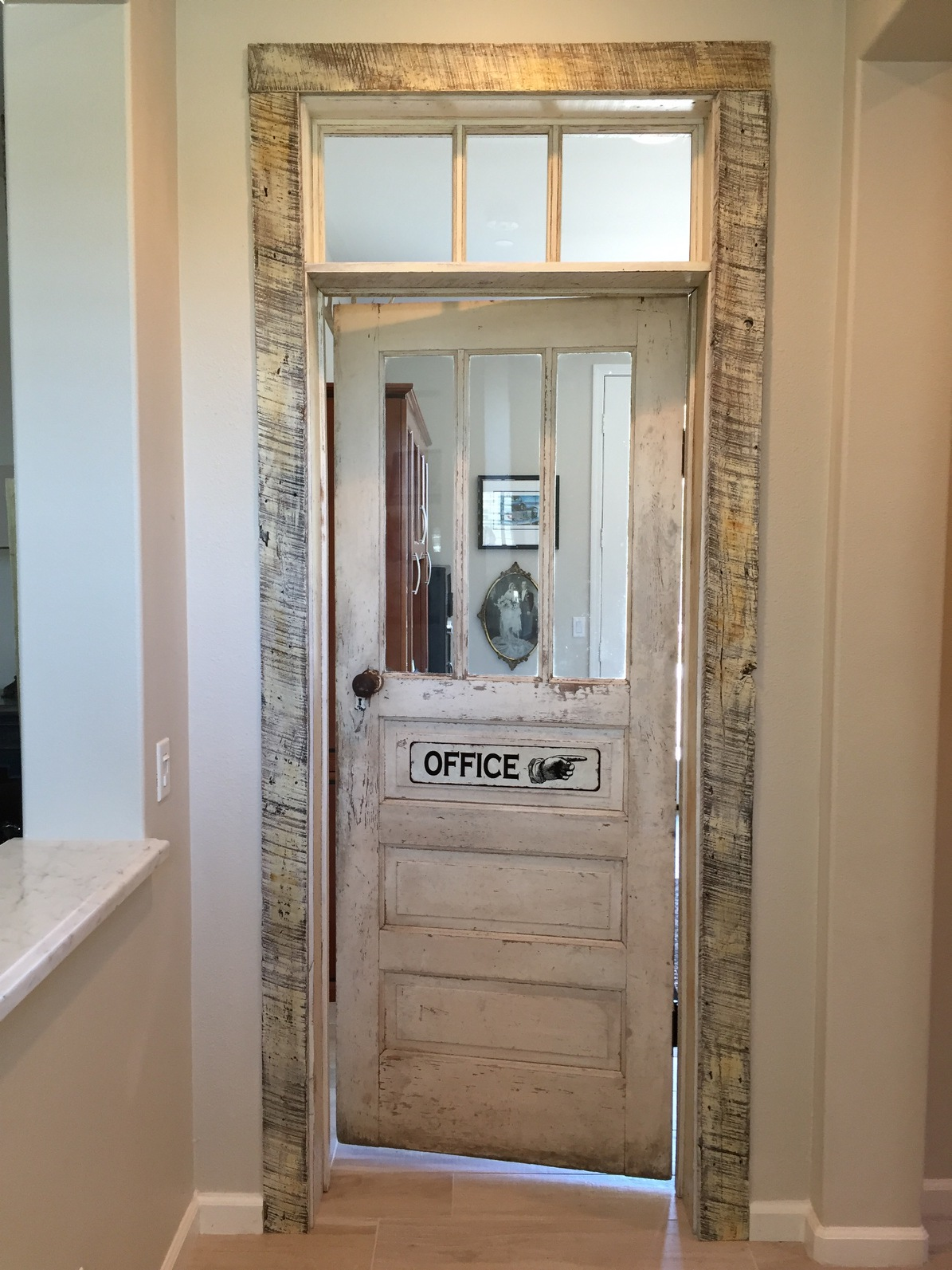 A customer recently purchased a reclaimed vintage wood door for the home office. The door and frame was custom finished to create the perfect accent for entry into the office. U.S. Reclaimed, Vintage Lumber & Wood Works offers a variety of vintage reclaimed doors. The vintage wood doors range in colors and sizes. Visit the store to check out the reclaimed wood and all other reclaimed inventory.