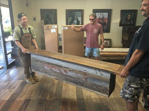 This happy customer is excited about his new wood bench; built with U.S. Reclaimed wood. The reclaimed wood used for this bench was chosen to create a custom and one of a kind piece of furniture. This wood bench is a lifetime piece built to make the customer happy. U.S. Reclaimed, Vintage Lumber & Wood Works appreciates the thumbs up from this satisfied customer. Contact or visit U.S. Reclaimed to get started on your custom piece. We are here to make our customers happy!