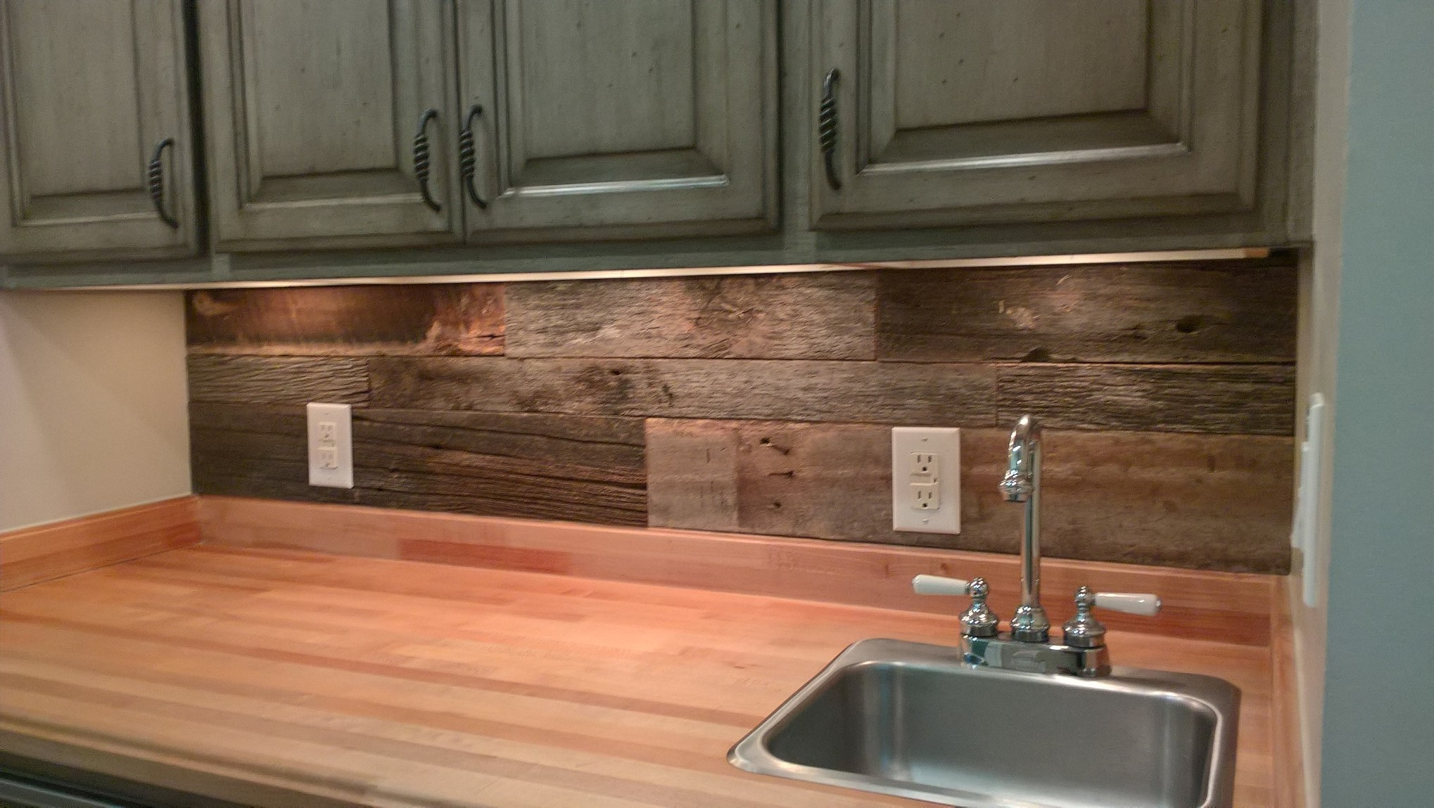 Reclaimed Wood can create a great accent wall to any space. The above picture is a wonderful example of how a little vintage lumber goes a long way. U.S. Reclaimed, Vintage Lumber & Wood Works offers the reclaimed wood needed to panel an accent wall. Visit the store to check out our reclaimed material.