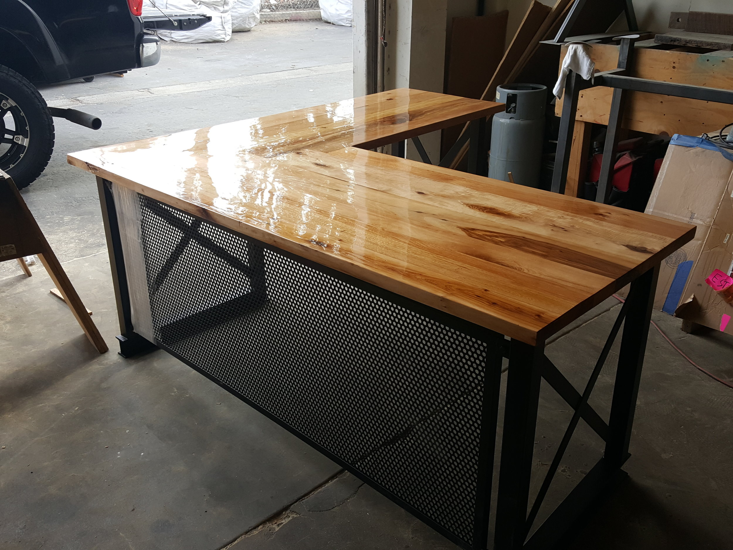 Custom desks with U.S. Reclaimed wood are one of the many custom pieces that are made and completed at our store in Laguna Niguel, California. All of our tables are built based on the design and preference of our customers. The desk in the above picture is complete with vintage U.S. wood along with a metal base that creates a wonderful style for a reclaimed wood desk. You can contact or visit our store to get started on a unique piece of reclaimed wood furniture.