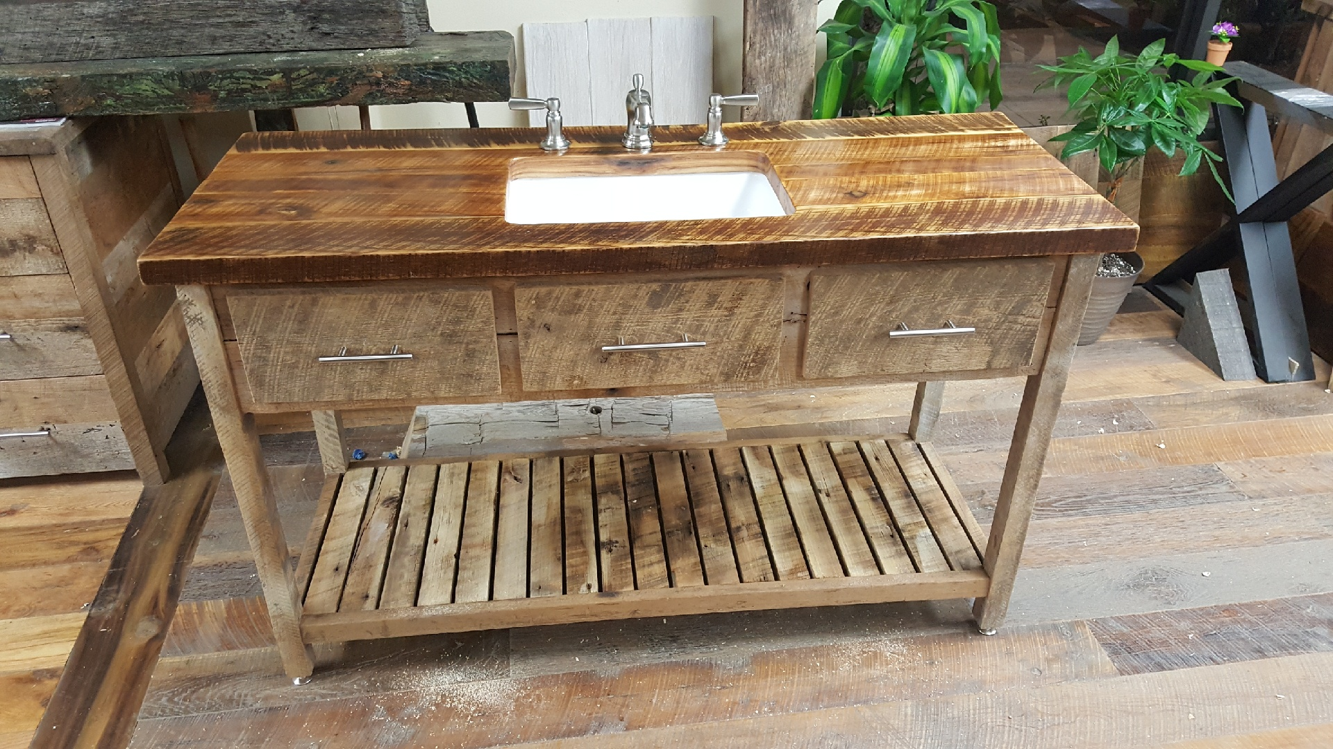 U.S. Reclaimed, Vintage Lumber & Wood Works can create a beautiful vanity with vintage reclaimed wood from across the United States. The vanity pictured above is just one of the many designs that can be custom created based on the customers wishes. Contact or visit the store to get started on any custom piece of furniture.