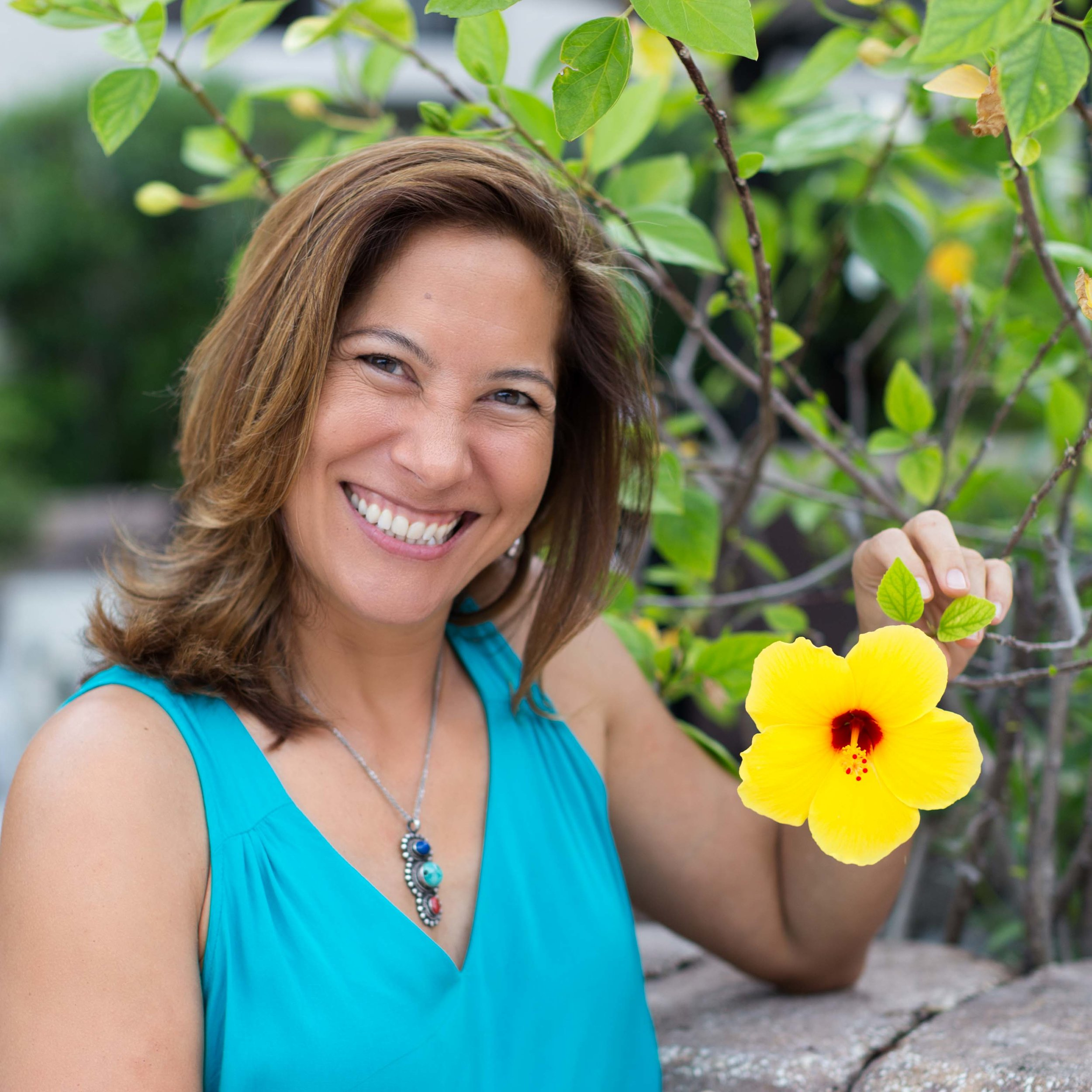 smiling-woman-holding-yellow-flower-photography