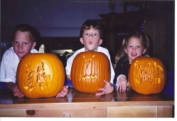 My kids on our favorite holiday! Carving pumpkins...not messy at all!