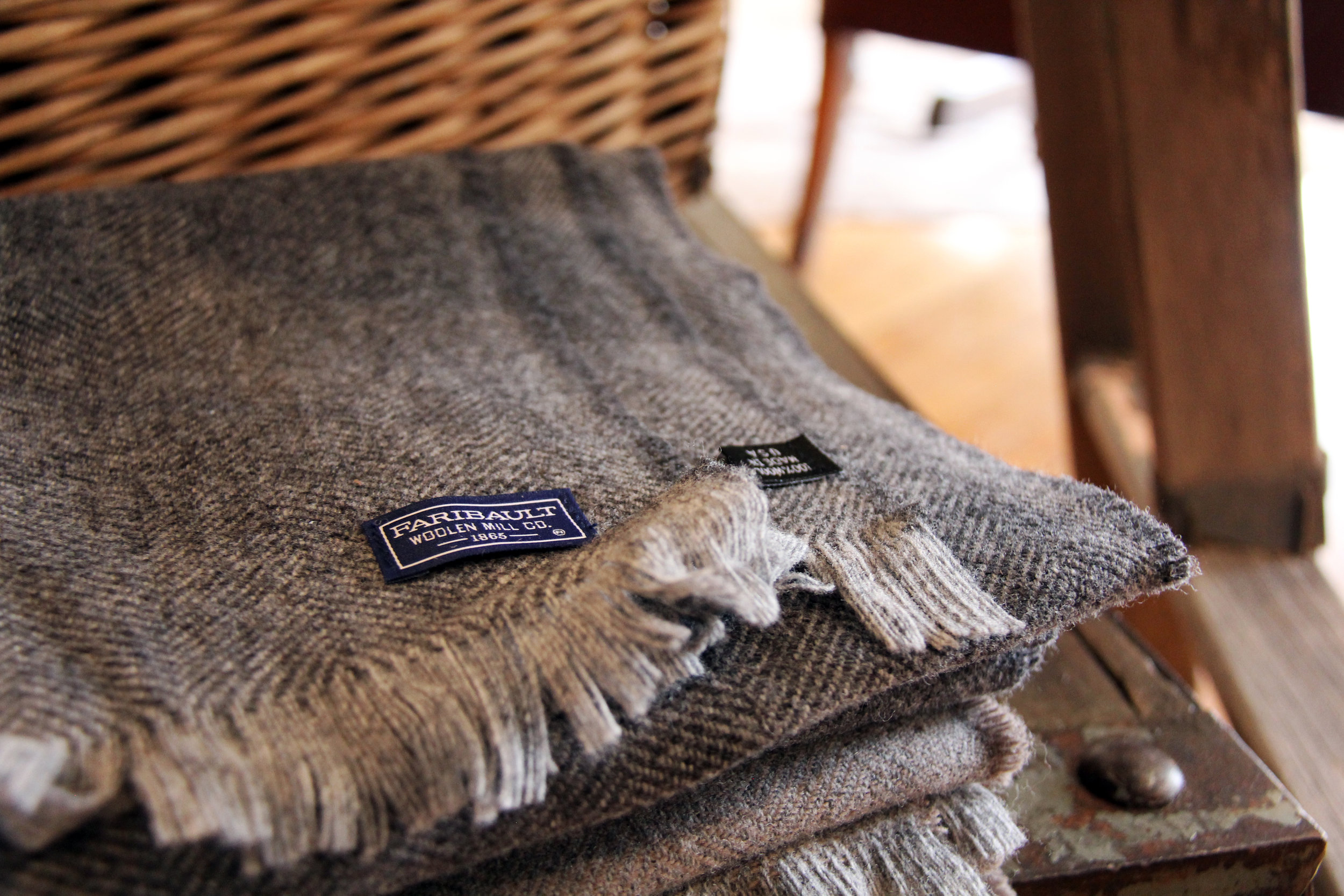 Wool scarves from Faribault Mill are great warm weather wear, and bonus, also make awesome runners and table decor