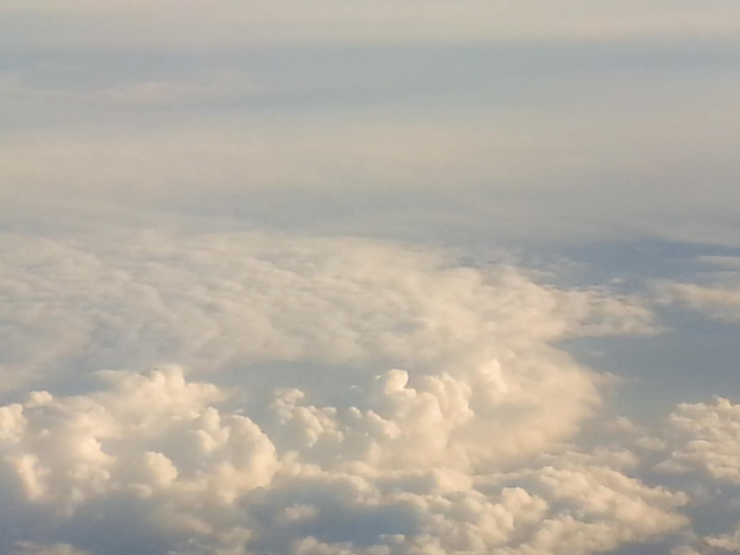 Glowing clouds above the Atlantic ocean