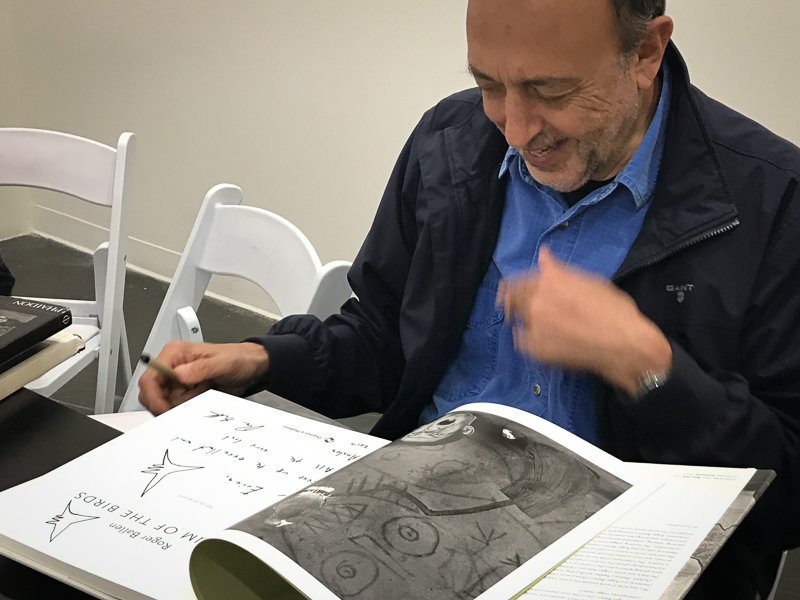 Roger Ballen signing his books - every book has its own kind of signature, each signature includes little drawings.