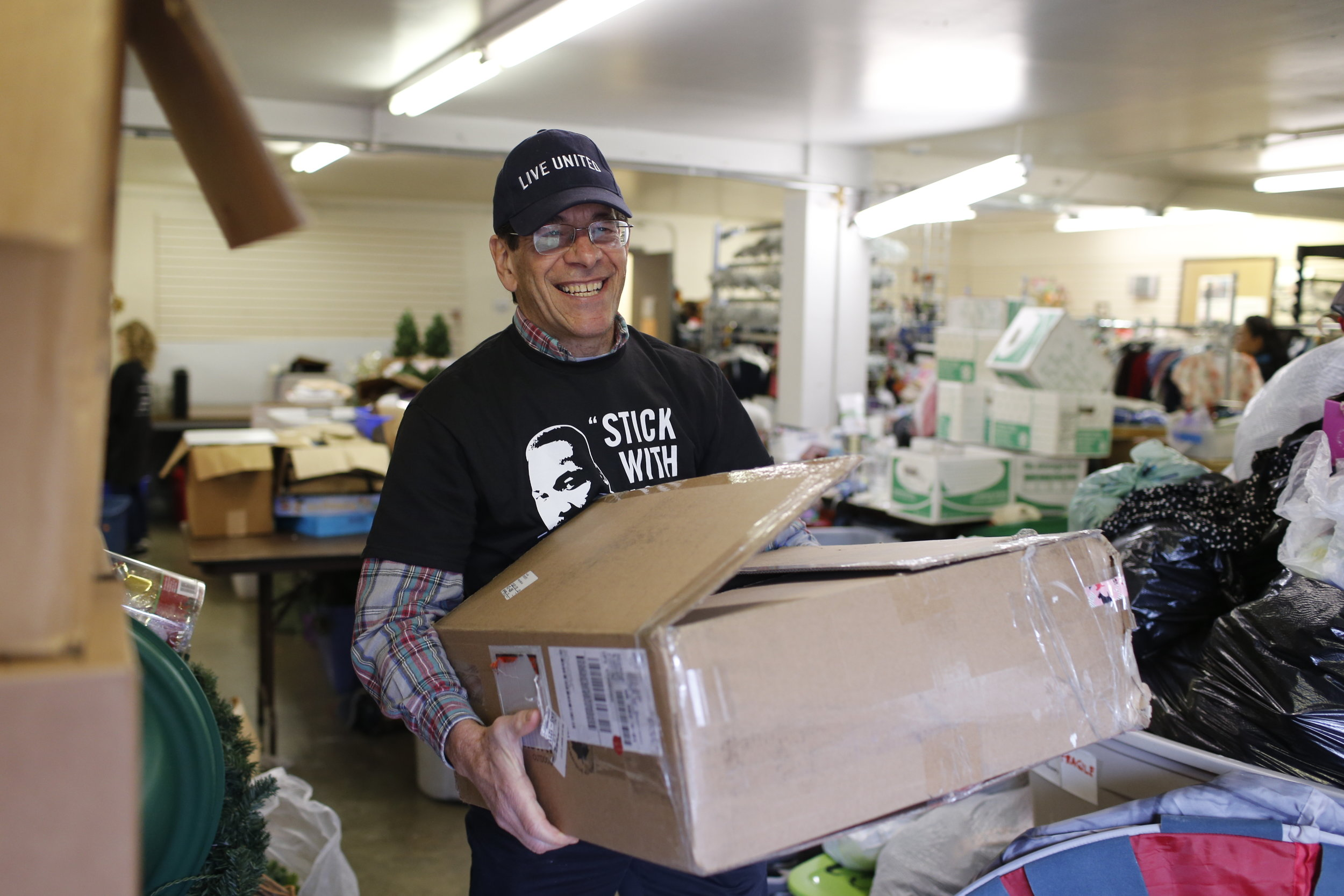 United Way of King County CEO, Jon Fine volunteering at the Jubilee REACH Thrift Store on 2018 MLK Day of Service