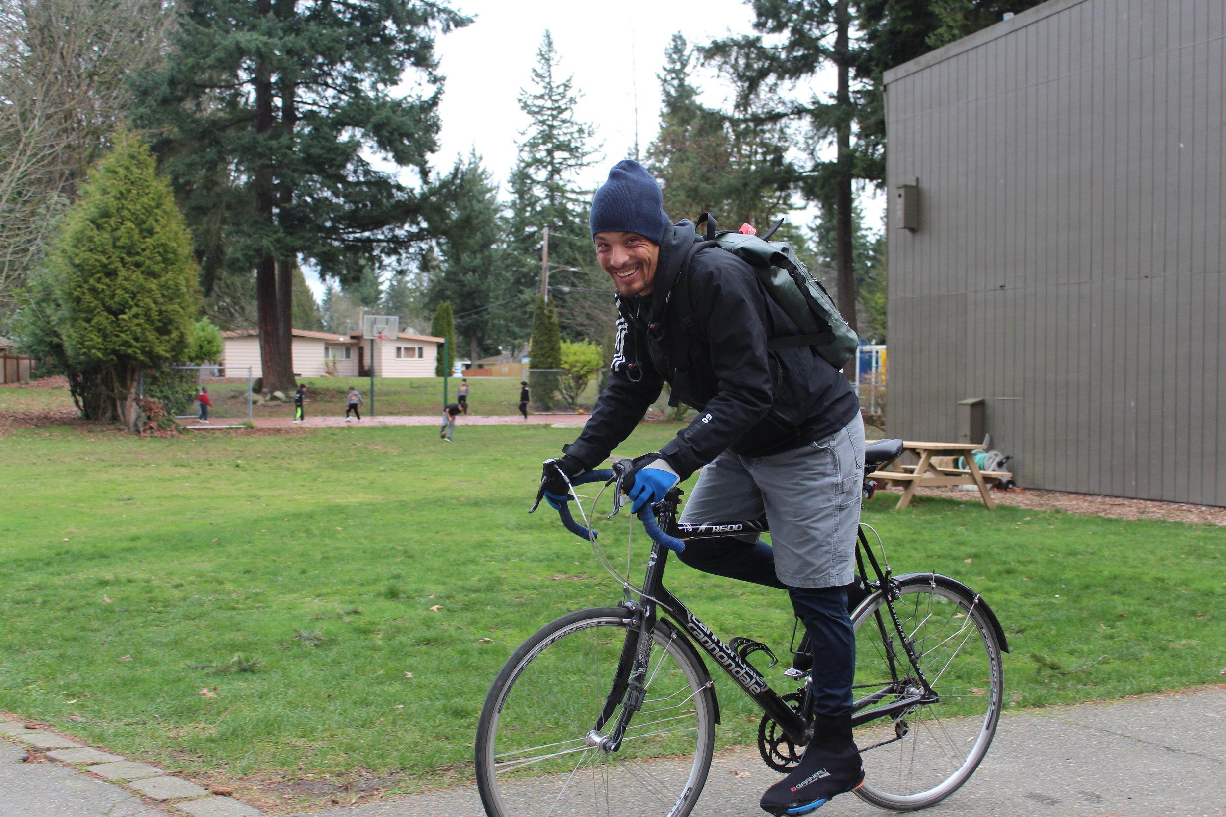 Coach Josh riding on his bike home