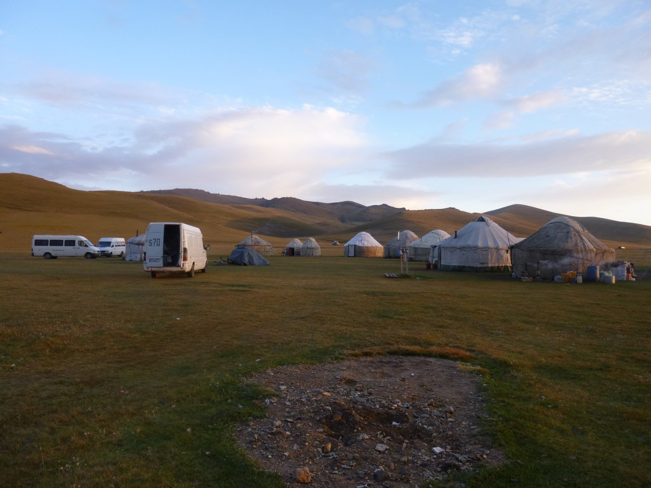 A yurt hotel (or Yurtel) is a collection of yurts, built to give tourists an authentic taste of Kyrgyz culture. The stove in each yurt burns dried dung and keeps the occupants toasty warm.