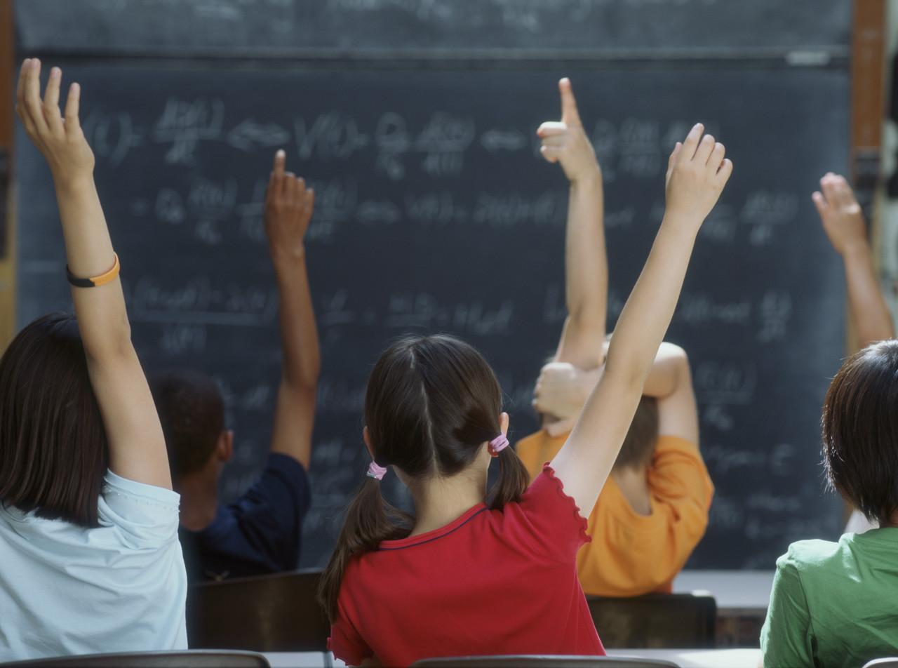students_hands_raised.jpg