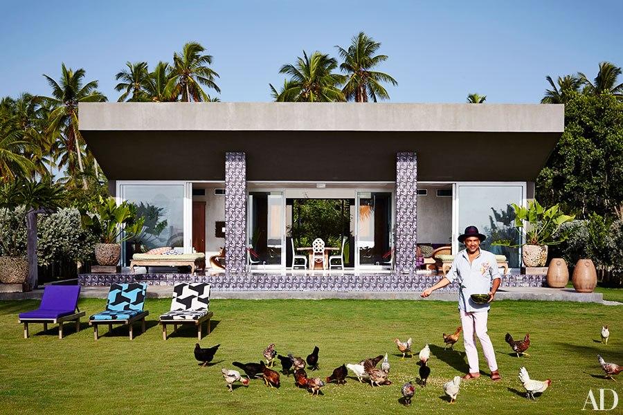 Carlos Mota feeding his chickens.