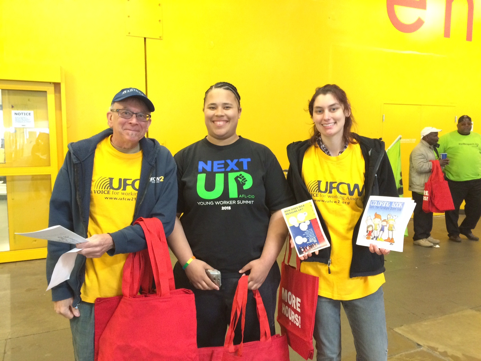 SAM CHASE (FAR RIGHT) WITH UFCW 21 MEMBERS AMES REINHOLD AND ARIANA DAVIS AT AN IKEA ACTION.
