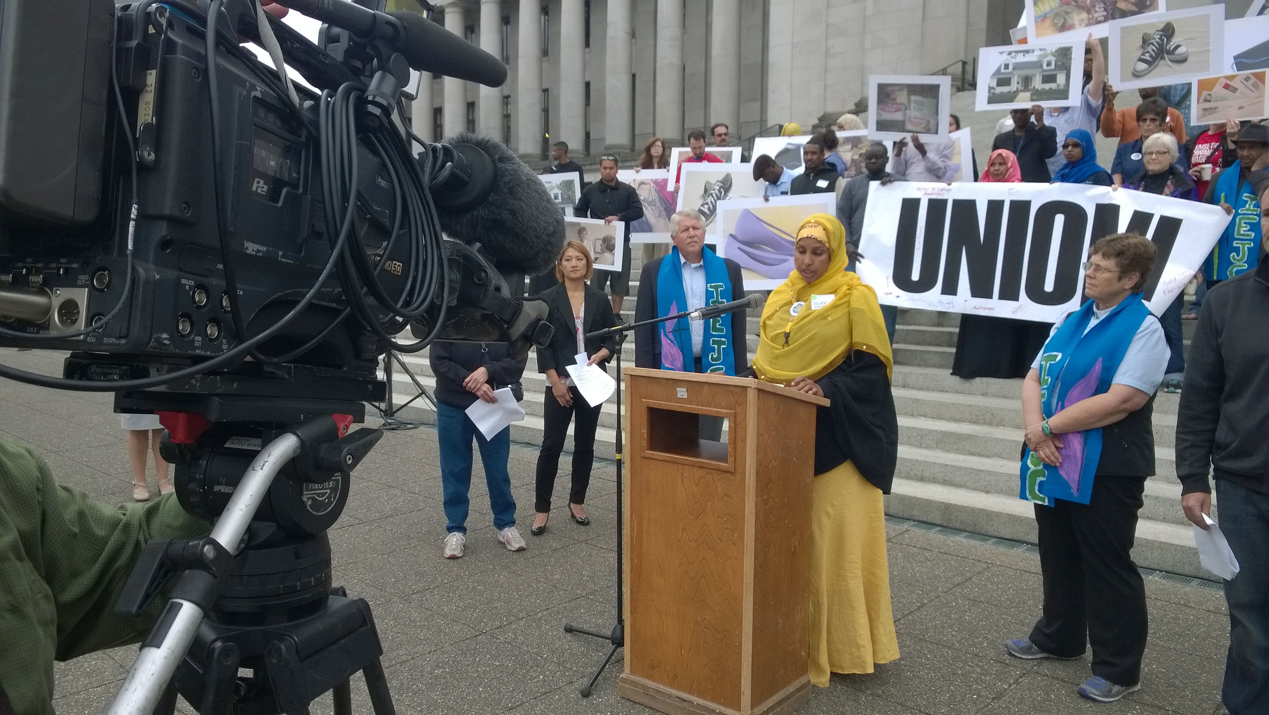 UFCW 21 member Shukri Hussien spoke on the steps of the Olympic court on June 26