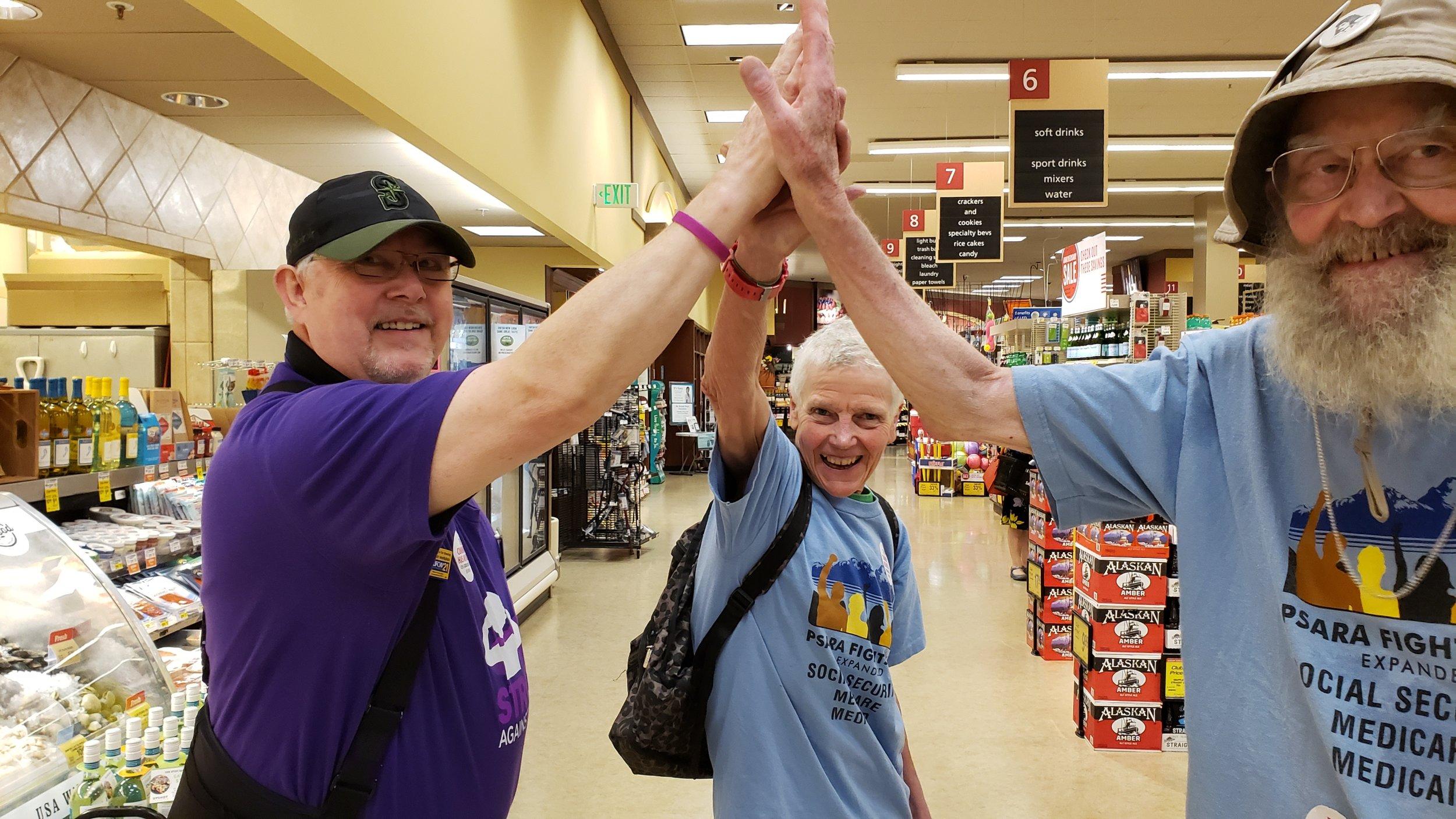 Pinehurst Safeway community worker high five 2.jpg