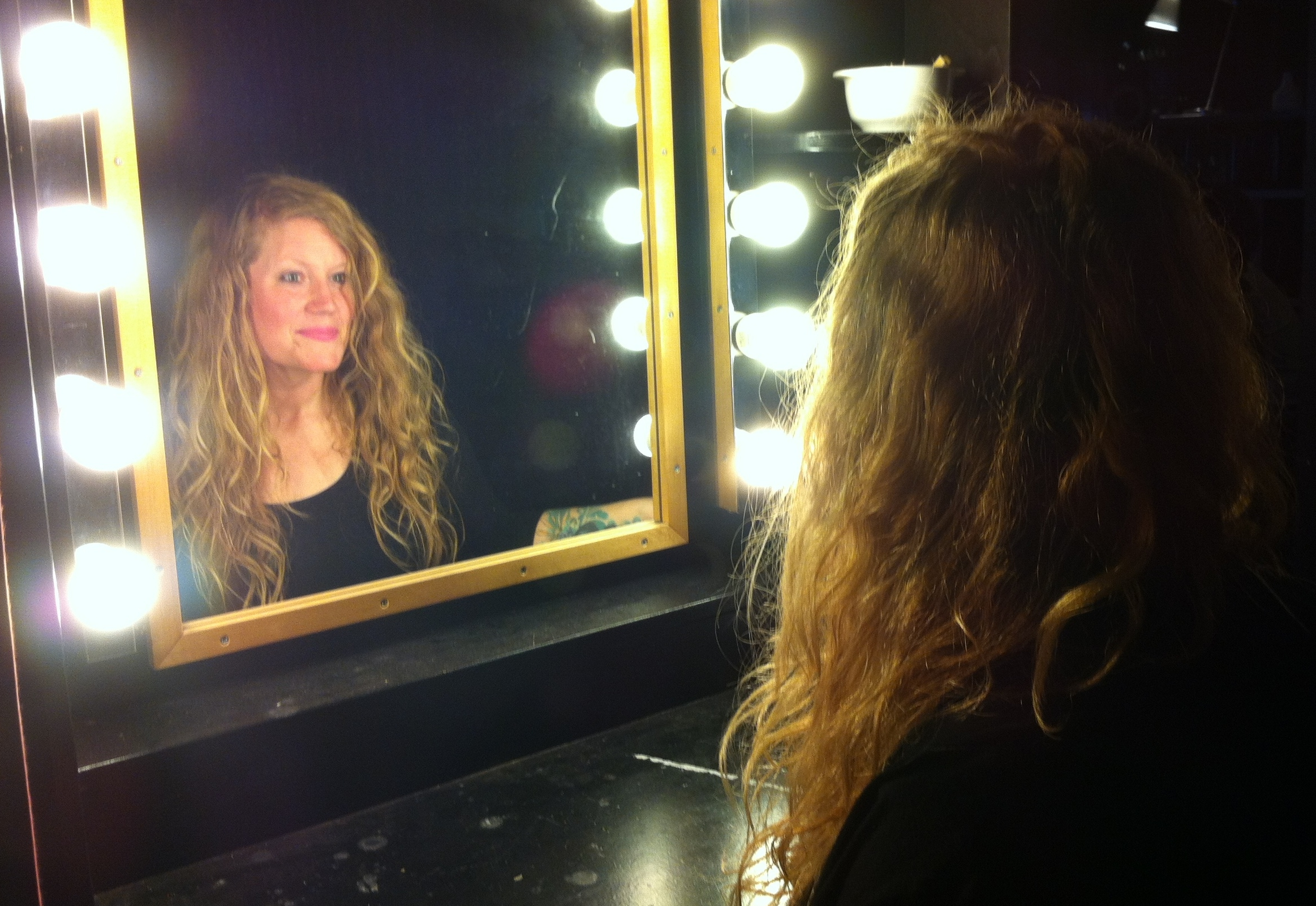 A_refelction_of_Lindsay_in_a_mirror_surrounded_by_lights