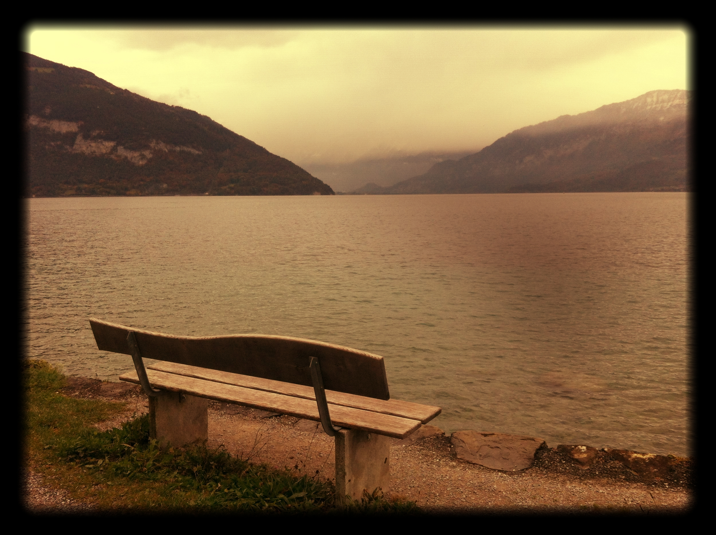 A_bench_on_a_lake_with_Mountains